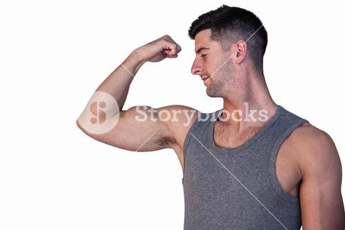 Attractive man showing biceps
