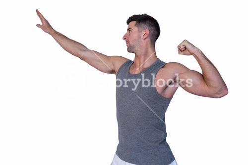 Fit man posing as he works out