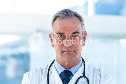Portrait of male doctor standing at hospital