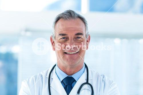 Portrait of smiling male doctor in hospital