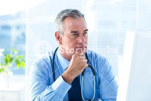 Thoughtful male doctor in hospital