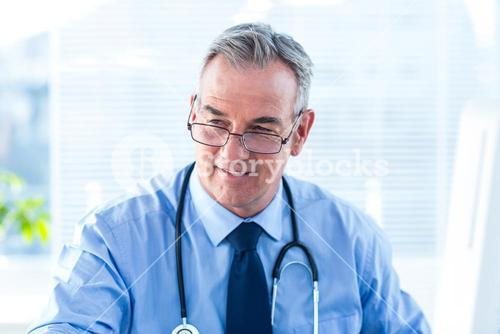 Male doctor looking away in clinic