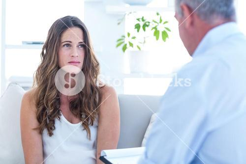 Psychiatrist advising female patient