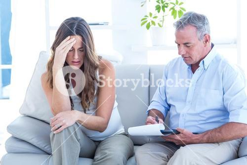 Psychiatrist advising depressed pregenat woman