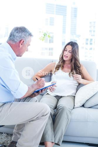 Psychiatrist advising preganant woman at home