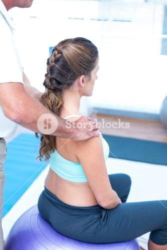 Pregnant woman having relaxing massage at gym