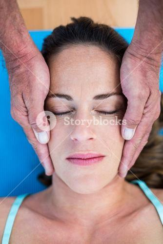 High angle view of therapist performing reiki