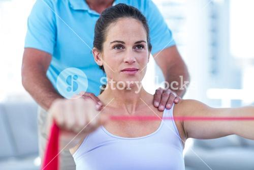 Pregnant woman stretching exercise band
