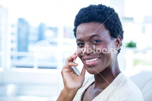 Happy woman with mobile phone at home