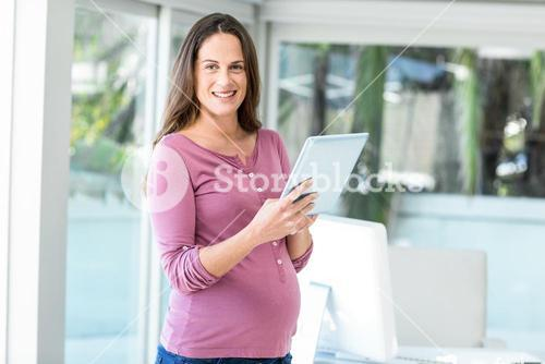 Portrait of happy woman using tablet computer