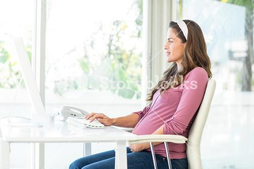 Side view of businesswoman working on computer