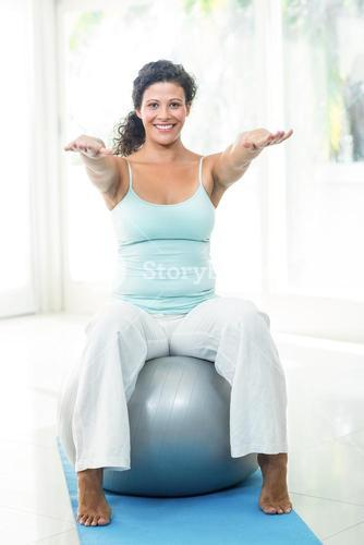 Pregnant woman exercising with ball