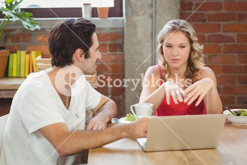 Businesswoman briefing colleague in office
