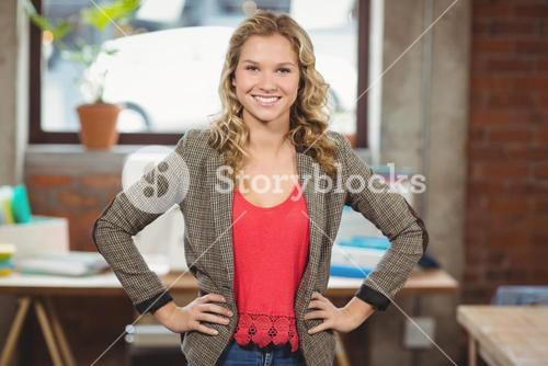 Portrait of confident businesswoman with hands on hip