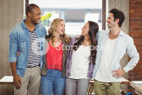 Business people standing and laughing in office