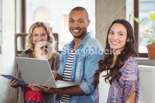 Happy business people using technologies in office