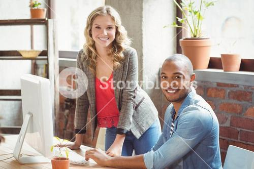 Smiling man and woman in  office