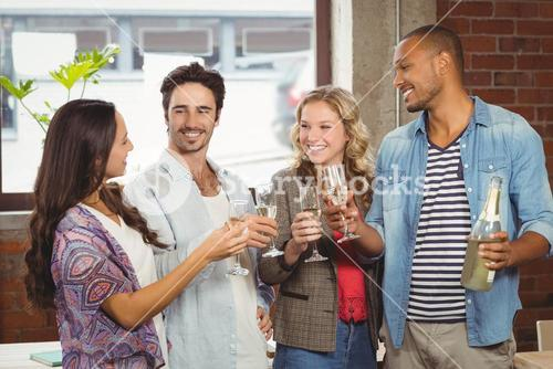 Business people toasting with champagne in office
