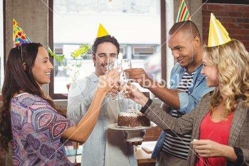 Colleagues toasting with champagne at birthday party