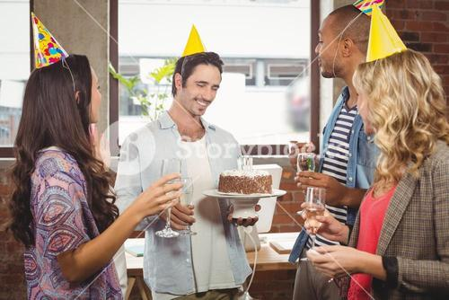 Business people enjoying at birthday party
