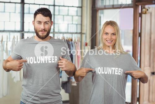 Man and woman showing volunteer text on tshirts