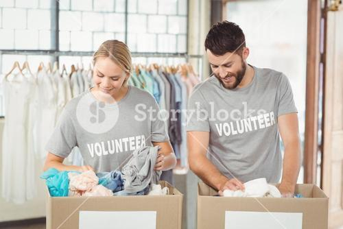 Volunteers separating donations clothes