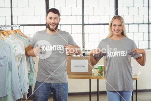 Portrait of volunteers showing volunteer text on tshirts