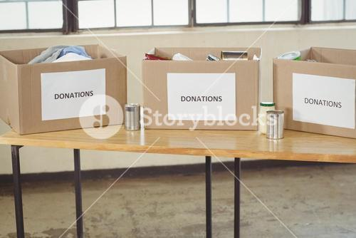 Cardboard donation boxes on table