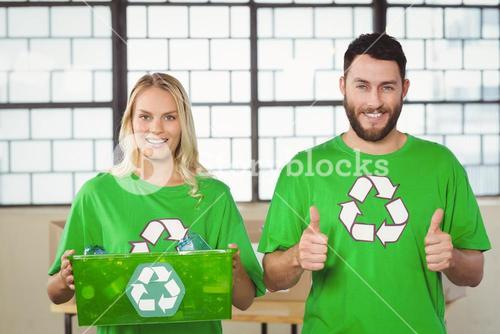 Portrait of cheerful volunteers in recycling symbol tshirts