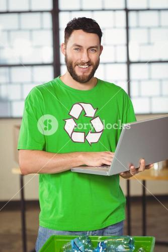 Portrait of happy man using laptop