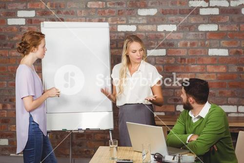 Businesswoman briefing colleagues in office