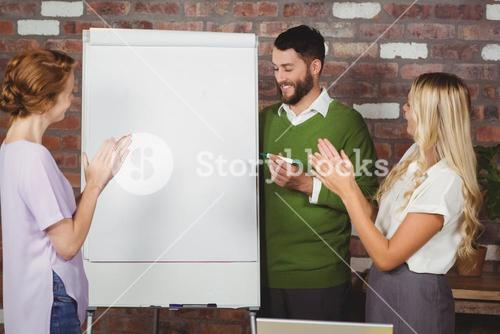 Women clapping for male colleague