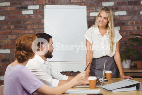 Businesswoman briefing over conference table
