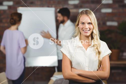 Portrait of smiling business standing