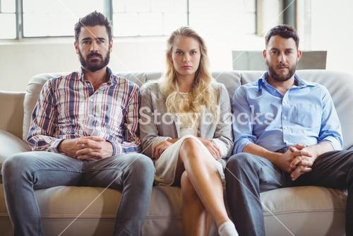 Portrait of serious business people sitting on sofa