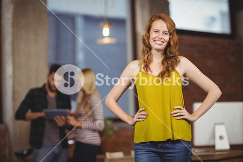 Young beautiful woman with hands on hip