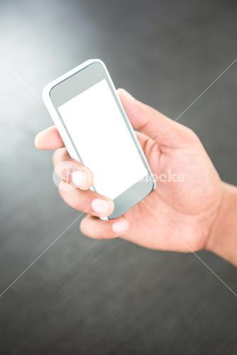 Hand of a businessman holding mobile phone
