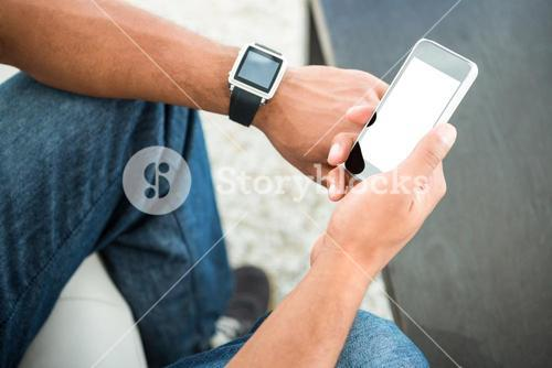 High angle view of man with smart devices