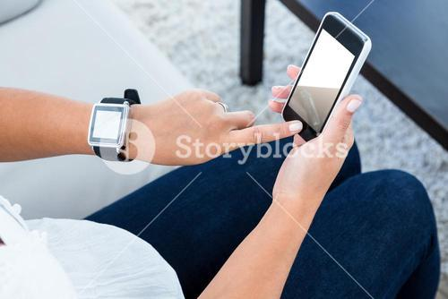 High angle view of woman scrolling on mobile phone
