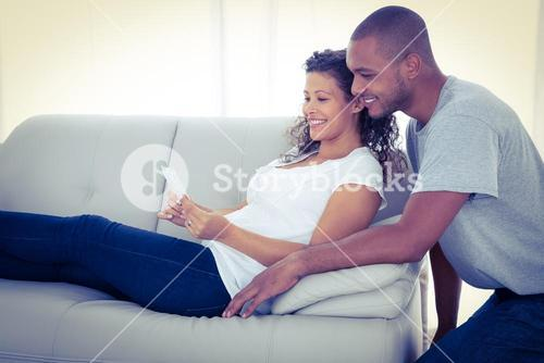 Young couple with sonogram