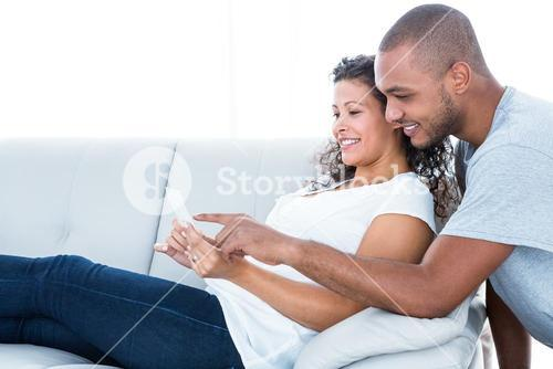 Happy couple looking at sonography