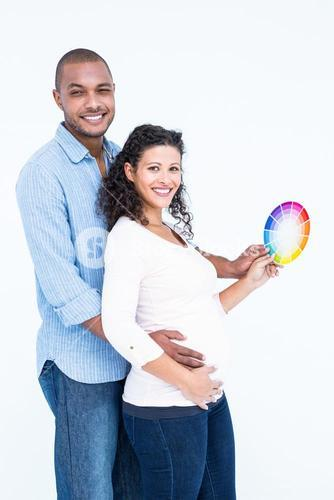 Portrait of smiling husband with wife holding color wheel