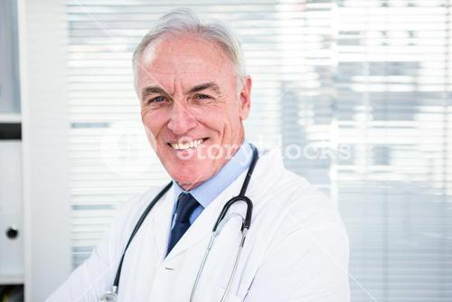 Portrait of happy doctor with stethoscope