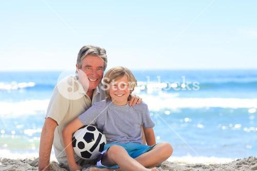 Grandfather and his grandson with a ball