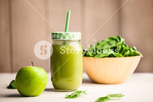 Juice jar with green apple and basil