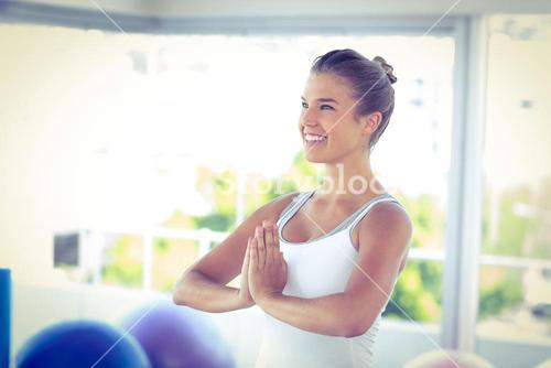 Beautiful woman smiling with hands joined