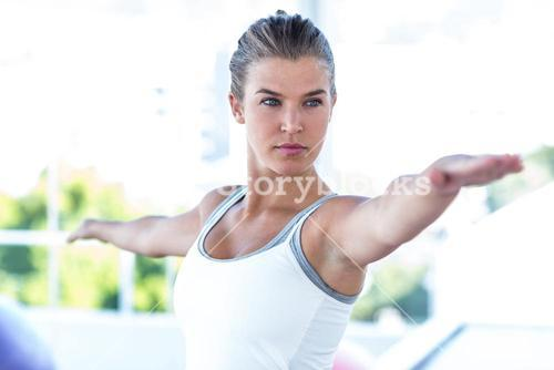 Focused woman with arms outstretched
