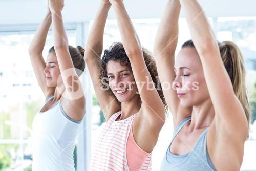 Sporty women with hands joined