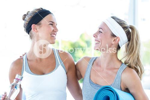 Women looking at each other and smiling