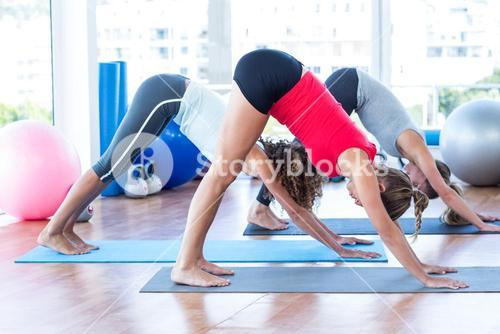 Side view of women doing downward pose